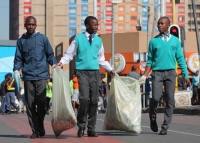 School learners clean the streets of Johannesburg