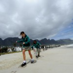 global_work_party_camps_bay_beach_green