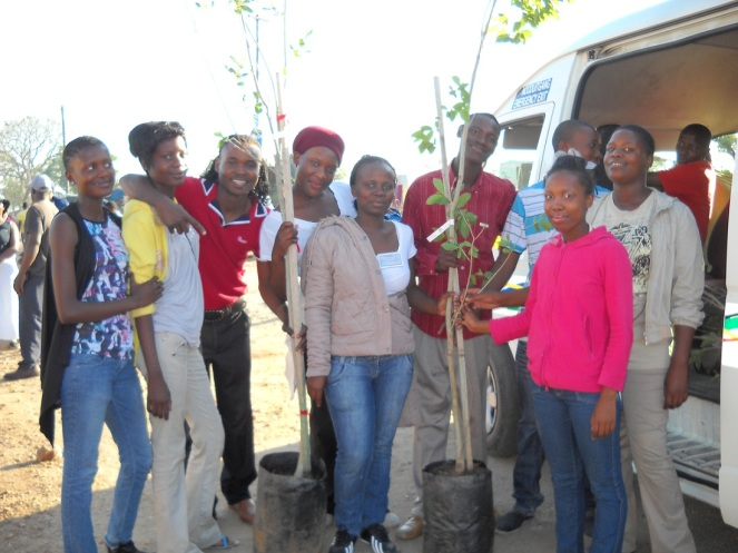 group poses with donated trees