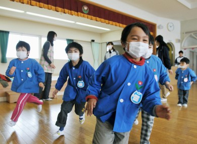 Japan Earthquake Fukushima nuclear explosion kids masks