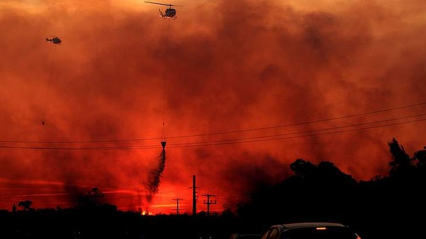 Helicopters-drop-water-on-a-fire-at-Doyalson