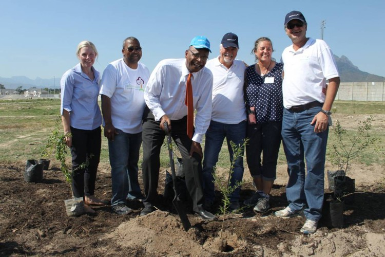 L to R – Louise Duys of Wildlands, Gerald Esau of Stellenbosch Municipality, the honourable Mayor Conrad Sidego, Kobus Verster of Mediclinic, Lydia Willems of Leaf a Legacy and Theo Pauw of Mediclinic – planting a tree to contribute towards the Million Trees project in Stellenbosch.