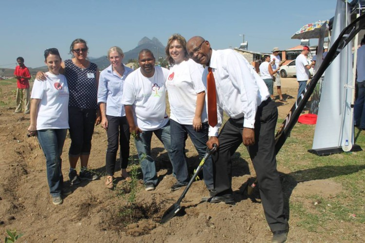 3 L to R – Sonja Morkel of Distell, Lydia Willems of Leaf a Legacy, Louise Duys of Wildlands, Gerald Esau of Stellenbosch Municipality, Corlia van Zyl of Distell and the honourable Mayor Conrad Sidego, do their bit during a tree-a-thon hosted today in Klapmuts as part of the 'Million Trees' project.