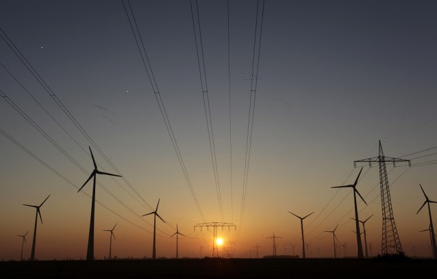 Wind turbines and transmission lines in Nauen near Berlin, Germany -  CREDIT: AP PHOTO/FERDINAND OSTROP