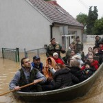 Serbian army soldiers evacuate people in boat in flooded town of Obrenovac, east from Belgrade