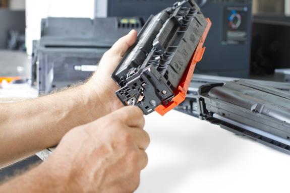 bigstock-Hands-Repairing-Toner-Cartridg-24035387