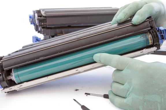 bigstock-Hands-Repairing-Toner-Cartridg-35144156