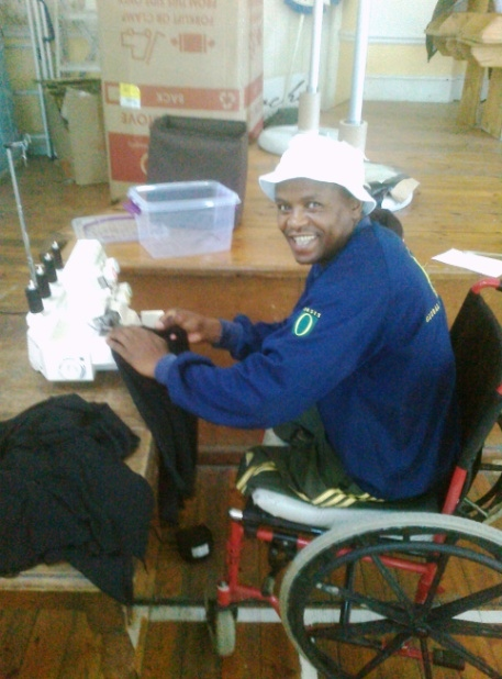 Zama Sonjica, a trainee of I-Scream and Red who is wheel chair bound due to a vehicle accident in 2008. After feeling drastically depressed after his loss of his legs, he now builds his confidence with every bag he completes. Today, Zama makes approximately 15 bags per day and sews pants and clothes for his 4 daughters.