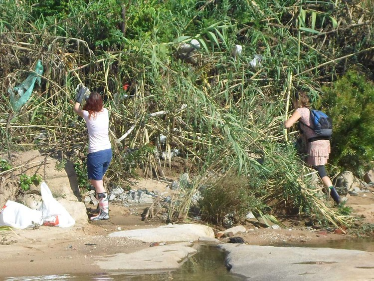 Community members remove rubbish from the waterways