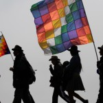 Protesters carry flags representing their indigenous movement as they advance towards the capital, in La Cumbre, Bolivia, Tuesday Oct. 18, 2011. Indigenous and environmentalist groups began an estimated 242-mile march from Trinidad to La Paz on Aug. 15 to protest a government planned highway that would cut through the Isiboro-Secure Indigenous Territory National Park, home to 15,000 indigenous people. After a police crackdown on marchers on Sept. 25, Morales announced the suspension of the highway, saying he will let voters in the affected region decide its fate. (AP Photo/Dolores Ochoa)