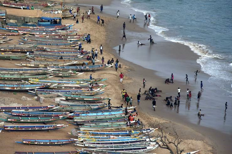 People fishing canoes Senegal climate change
