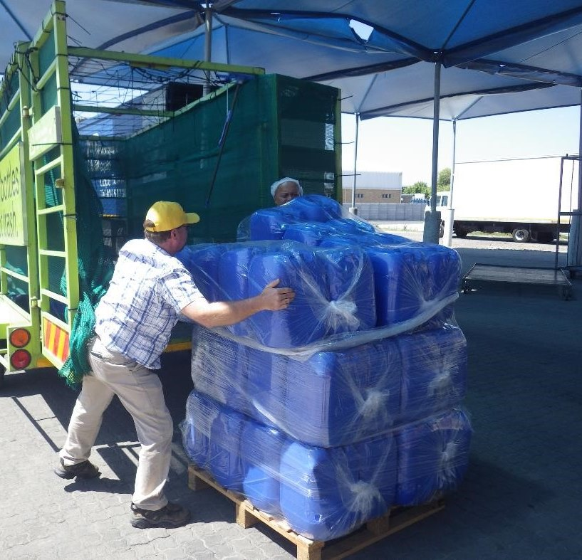 Plastics SA technical trainer Grant Crosby helps get water ready for distribution
