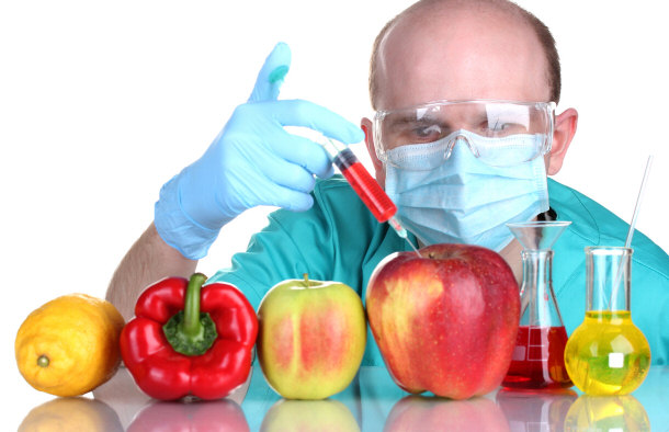 scientist-injecting-gmo-fruit-peppers-health-youth-green-times