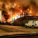 Thousands evacuated as Canadian wildfire spreads South