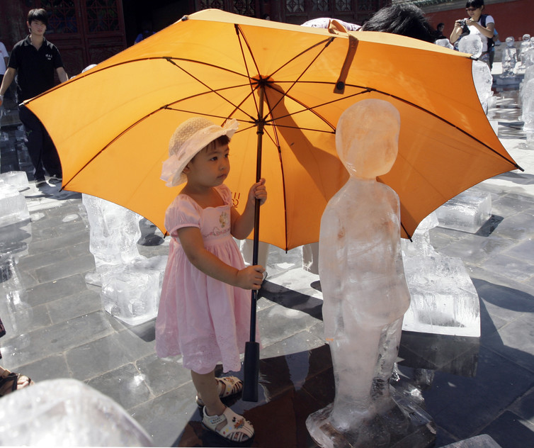 girl umbrella climate change greenpeace