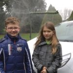 Clever kids use rainwater to clean windscreen