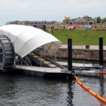 Solar-powered water wheel cleans Baltimore Harbor