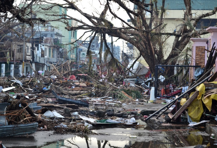Debris lines the streets of Tacloban, Leyte island. This region was the worst affected by the typhoon, causing widespread damage and loss of life. Image: Eoghan Rice / Wikipedia
